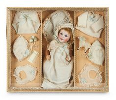 Fine French Bisque Art Characters, 236, Size 0, by SFBJ in All-Original Presentation Trousseau Box. Lot # 111.