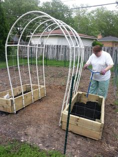 """Trellis is made from ten 10' pieces of 1/2-inch exterior grade PVC. The sides are ten 4-1/2' pieces,  the arches are five 5-1/2' pieces with eight 1' sections to help stabilize. Four 3-pronged 1/2"""" PVC connectors, six 1/2"""" 4-pronged PVC connectors, and 20 1/2"""" galvanized U-shaped brackets. The netting is made of cotton chalkline tied and knotted across all poles and then up and over to divide the sections, which are 1' wide."""