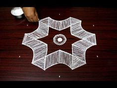easy muggulu rangoli with dots for the special festival season of Durga Puja Simple Rangoli Designs Images, Rangoli Designs Diwali, Easy Rangoli, Beautiful Rangoli Designs, Kolam Designs, Simple Designs, Padi Kolam, Indian Rangoli, Rangoli With Dots