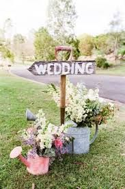 Amazing Farm Wedding Signage   Arrow On A Spade With Galvanised Watering Cans