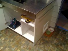 Litter box built into cabinet