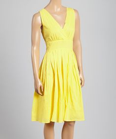 This Yellow Pleated Surplice Dress by Aryeh is perfect! #zulilyfinds