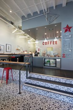 Arcsine Architecture have transformed a dull and dated retail space with green carpet, beige walls, and drop ceilings, into a contemporary coffee shop named Modern Coffee, located in Oakland, California.