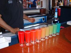 I have to find this somewhere. Rainbow shot. The bartender mixes all in a shaker and pours the shots down a row, as they go along different colors come out. EEEEP!! So cool!