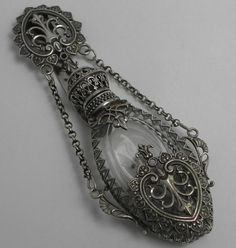 Beautiful is an understatement. === Beautiful Victorian Silver Chatelaine Scent Perfume Bottle, photo via Nina Eary. Perfumes Vintage, Antique Perfume Bottles, Vintage Bottles, Antique Jewelry, Vintage Jewelry, Victorian Jewelry, Victorian Era, Vintage Silver, Antique Silver