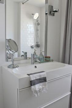 Modern Jane Bathroom Renovation. Marble hexagon and white subway tile. Ikea Godmorgon vanity.