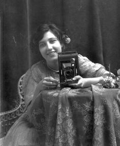 Susan Sontag with her folding camera.