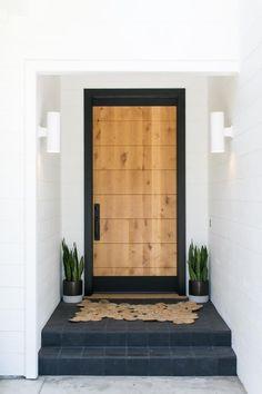 Give your home's entryway an easy update by changing your house numbers. See 35 chic ways to display them. #FrontDoorIdeas #Entryways #CurbAppeal Diy House Number Plaques, House Numbers, Natural Wood Coffee Table, Concrete Retaining Walls, Modern Family Rooms, Modern Fire Pit, Modern Ranch, Modern Planters, Modern Light Fixtures