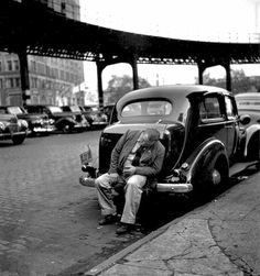 Fred Stein  Man on bumper, New York, 1949.