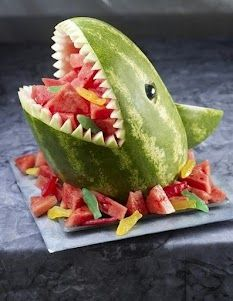 It`s not a cake, but that is a pretty darned cool shark watermelon.