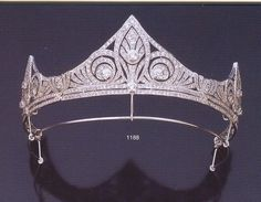AN ART DECO DIAMOND AND GOLD TIARA. Provenance: Royal Family of Spain. A white gold band with three points featuring openwork of three stylized lilies set with brilliant cut diamonds. Royal Crowns, Royal Tiaras, Tiaras And Crowns, Diamond Tiara, Diamond Cuts, Gold Tiara, Antique Jewelry, Vintage Jewelry, Royal Jewelry