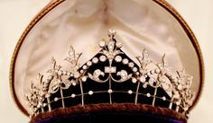 A VICTORIAN DIAMOND TIARA/NECKLACE  Designed as a series of graduated old-cut diamond fleur-de-lys motifs to the knife-edge bars and diamond collet frame, mounted in silver and gold, with later backchain, circa 1890, 12.3 cm wide, in original brown leather fitted case by Rood & Co Ltd, London