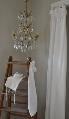 love the old ladder with the chandelier....and the white curtain.....sweet
