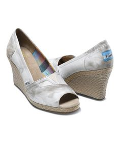 The perfect sunny-weather shoe with all the perks TOMS has to offer. The espadrille-style wedge heel is lined with a comfortable suede insole, while the rubber sole provides additional cushion. And with the purchase of every pair of TOMS shoes, another pair is given to a child in need somewhere in the world. Size note: TOMS run true to size. If you're typically in-between sizes, TOMS recommends ordering smaller since TOMS shoes will stretch with wear.