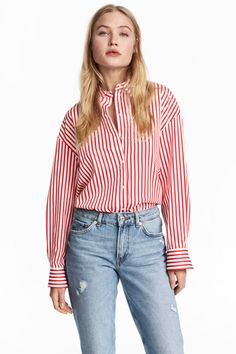 Check this out! Loose-fit shirt in cotton poplin with a collar. Dropped shoulders, buttons at front, and buttons at cuffs. Rounded hem with slits at sides. - Visit hm.com to see more.