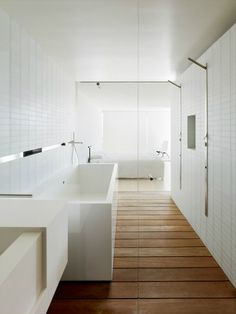 White bathroom with wooden floor