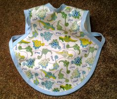 Waterproof Bapron/The Baby Apron - 6-18 months with Dinosaurs/blue trim by GrandmaSewsBest on Etsy