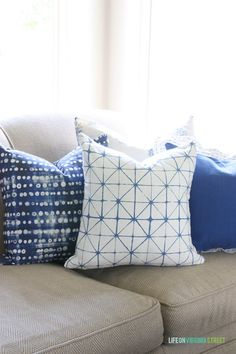 DIY Blue and White Living Room Throw Pillows. Can't believe some of these were made from napkins!