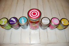 This is a cute idea for kids... they get a trinket from the smaller jars for different chores/tasks (such as washing their hands or doing dishes), and they put it in the big jar.  When the big jar is full, they get a reward (like a trip to the toy store, or whatever).  Hmm... this may work for boyfriends/husbands too, lol!