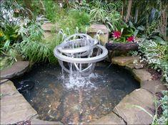 estanque de jardn con fuente moderna de metal
