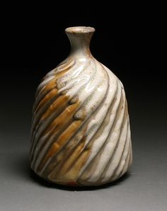 Love the primitive feel to this Ceramic Bottle - created by Steve Murphy - wheel-thrown and carved  stoneware clay with wood-fired shino glaze.