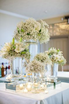 Using the biggest arrangement in this photo as an example ... if none of the flowers you want are in-season and affordable, preserve Baby's Breath and Queen Anne's Lace white flowers using glycerine ... then when you're ready to make a huge arrangement one only has to add a few large fresh flowers or 'treated' crepe-paper roses, etc