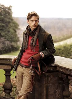 Polo Ralph Lauren Fall 2012 - Brown jacket, red sweater, tan riding pants, brown stripe scarf, brown belt, cordovan gloves, brown knee length boots,