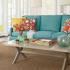 Living Room | aqua sofa, pops of yellow & orange