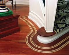 floor in Brazilian cherry is offset with a maple and wenge bentwood border Art Deco Bar, Wood Flooring Company, Flooring Companies, Floor Design, Building Materials, Animal Print Rug, Hardwood Floors, Tent, Stairs