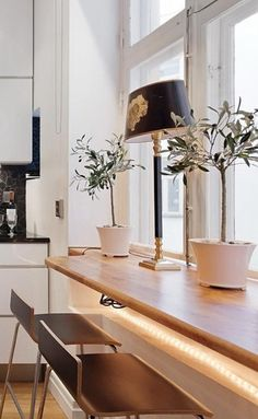 if your kitchen is small, use the windowsill as a breakfast zone, add potted greenery and lamps