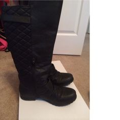 Add some style to your closet with these lovely boots with unique accents. Ridding boot. Quilted upper, straps and metal buckles. Heal height 1 inch shaft height 15. Little wear to bottom.