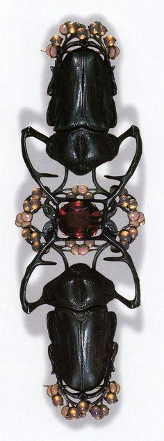 Blister Beetle Corsage Ornament by René Lalique, ca.1903-04. Gold, silver, tourmaline, enamel, glass; 14.9 cm long: