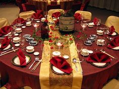 Wedding reception table decoration for Asian or Indian wedding theme.  The red and gold in this table decor goes great with the bamboo red and gold wedding invitation and matching stationary.