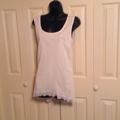 Sequined Tank Top. Creme color. Cute ruffled bottom. Gold sequins with Creme color overlay. Apostrophe Tops Tank Tops