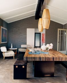 Loving the butcher block dining table and small breakfast nook in the corner.