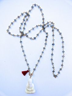 "Diane Moss Jewelry: Labradorite beaded 32"" long necklace with white bone Buddah pendant and red silk tassel. $95 on Etsy.com"