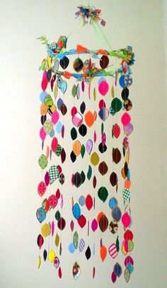 Cute Bedroom mobile idea- (Fabric scraps mobile)- Note: This would be easy to use scrapbook paper too. Note: Art group project idea for my students when we learn about shapes.