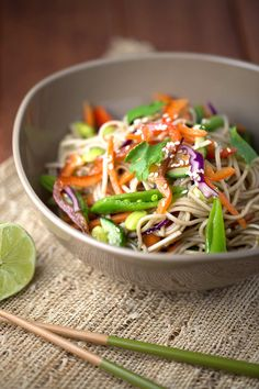 Bowl of Asian soba noodle salad with citrus dressing | jessicagavin.com