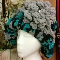 "NEW ""THE CHARLOTTE"" HANDMADE HAT Handmade crochet hat. Very sold and chunky yarn. Warm, stylish and unique. You will not see another person in your town with this hat. This is my original design...no pattern :). Colors are gray, turquoise, blue, and black.  It is a hat that will fit snug around your forehead. handmade Accessories Hats"