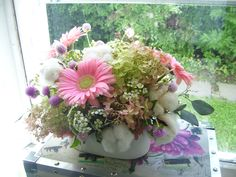 Feminine bouquet mix with pink gerbera daisies, waxflower, lavender gomphrena and cotton!  Roberts Flowers of Hanover, Hanover, NH