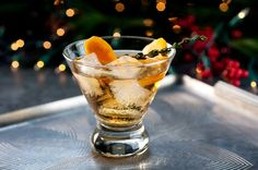 The Tabard Cocktail: a tequila, sherry and Drambuie concoction with orange bitters and a garnish of orange peel and thyme.