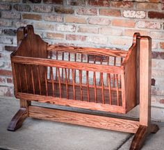 Swinging wooden baby cradle handmade from red oak by 33RPMs