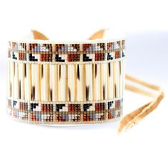 Look how Caroline Blechert transforms porcupine quills and beads into a stunning cuff by weaving them in such a striking pattern. View her collection online now, just click on artists >> shop.beyondbuckskin.com