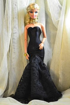 Black dress.....like how this nice evening gown made the playline doll look really beautiful.
