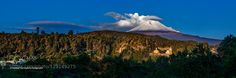 Panoramic view forme the Best sunrise with the Popocatpetl well capped and lenticular clouds over