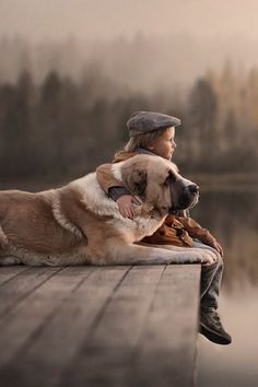 There is no greater love than that of a boy and his dog.... such a beautiful photo.