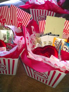 Valentines Day Movie Baskets. Would be fun to make a version of these for the kids for the time we're out to dinner.
