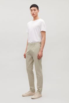 Model front image of Cos stretch-cotton chinos in brown