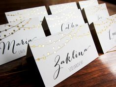 Fairy lights Wedding Place Cards, Name Place Setting, Dinner Cards, Reserved Seating Cards, with gold foil by LittleBridgeDesign on Etsy https://www.etsy.com/listing/211197166/fairy-lights-wedding-place-cards-name