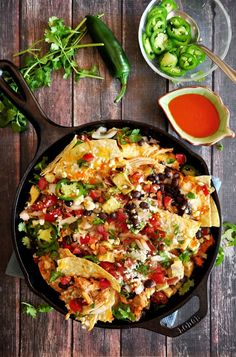 Three-Cheese Buffalo Chicken Nachos The best gooey, tangy, spicy buffalo chicken nachos you've ever had. Loaded with three types of cheese and fresh, Mexican-style ingredients. Ready in 20 minutes. Buffalo Chicken Rolls, Buffalo Chicken Nachos, Mexican Food Recipes, Vegetarian Recipes, Healthy Recipes, Ethnic Recipes, Healthy Food, Delicious Recipes, Free Recipes